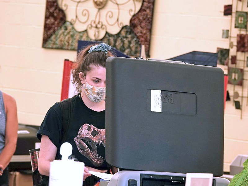 An Orange County resident casts her vote Oct. 15 in Hillsborough. Jake Axelbank / Carolina Public Press