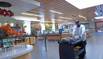 Charles Gooch, a Duke Food Service employee, pushes a cart