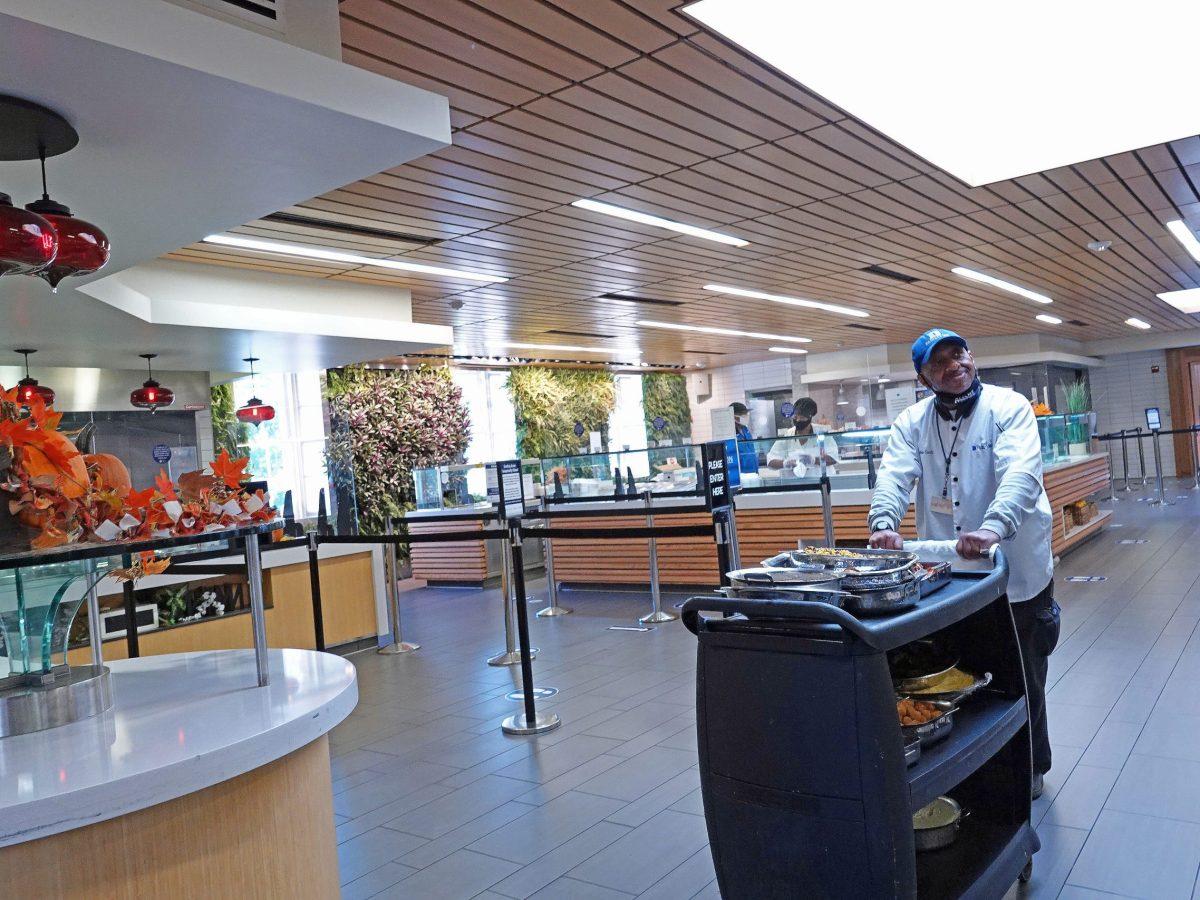 Charles Gooch, a Duke Food Service employee, pushes a cart