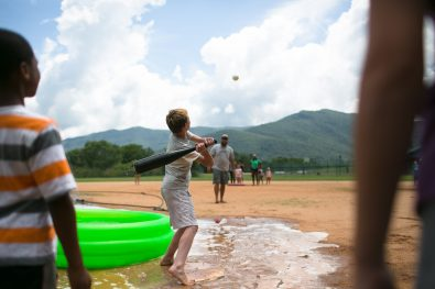 Residents of Black Mountain Children's Home cool off with a game of water wiffle ball on Thursday at the facility in eastern Buncombe County. (Colby Rabon / Carolina Public Press)