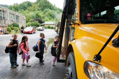 Kids board the bus to head home at the end of the first day of school at Bee Log Elementary School. (Matt Rose/Carolina Public Press)