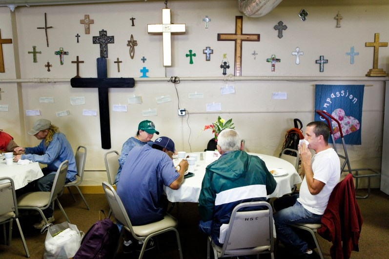 Anyone -- those with homes or those without -- can come to the Haywood Street Congregation for a meal, says Rev. Brian Combs, adding that the tables are round for a reason. (Matt Rose / Carolina Public Press)