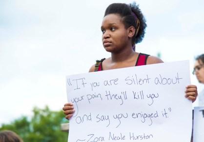 Shanita Jackson stands in protest of police brutality. (Alicia Funderburk/Carolina Public Press)