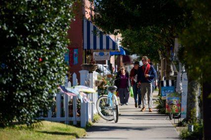 People walk through downtown Southport. Melissa Sue Gerrits / Carolina Public Press
