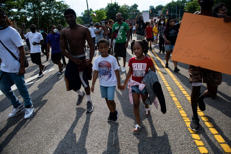 Kids walk down Hay Street as demonstrations take place in Fayetteville, North Carolina on May 30, 2020 in reaction to the death of George Floyd. (Melissa Sue Gerrits/The Carolina Public Press)