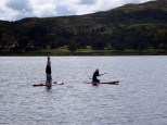 David showing me how to do a head stand while floating on a paddleboard.