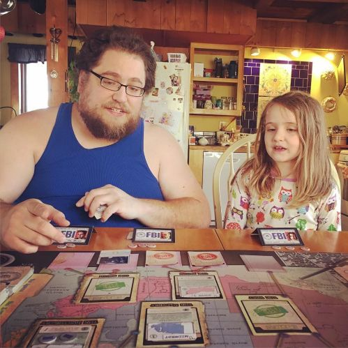Teaching_Ellie_how_to_play_The_X-Files_board_game___thexfiles__games