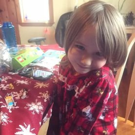 Workin' on her LEGOs in her new Christmas jammies.