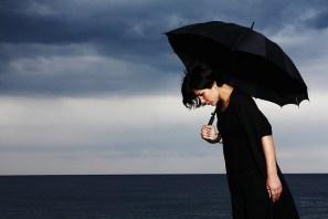 Woman with black umberella
