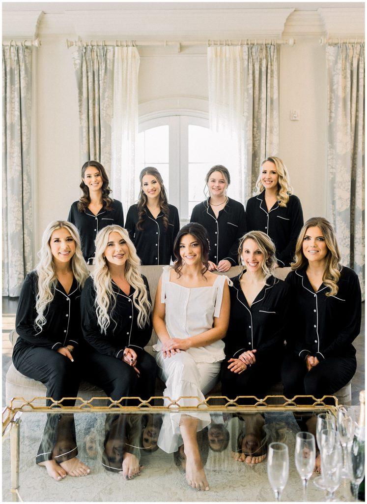 bridesmaids wearing black matching pajamas at Park Chateau