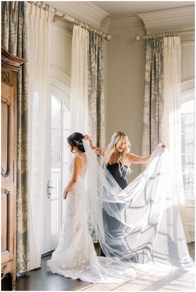 bridesmaid putting on cathedral veil at Park Chateau in New Jersey