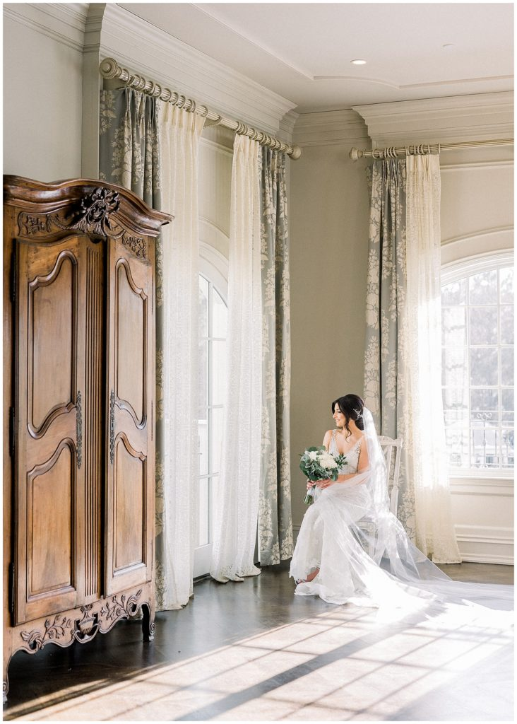 bride sitting in bridal suite in Park Chateau in New Jersey