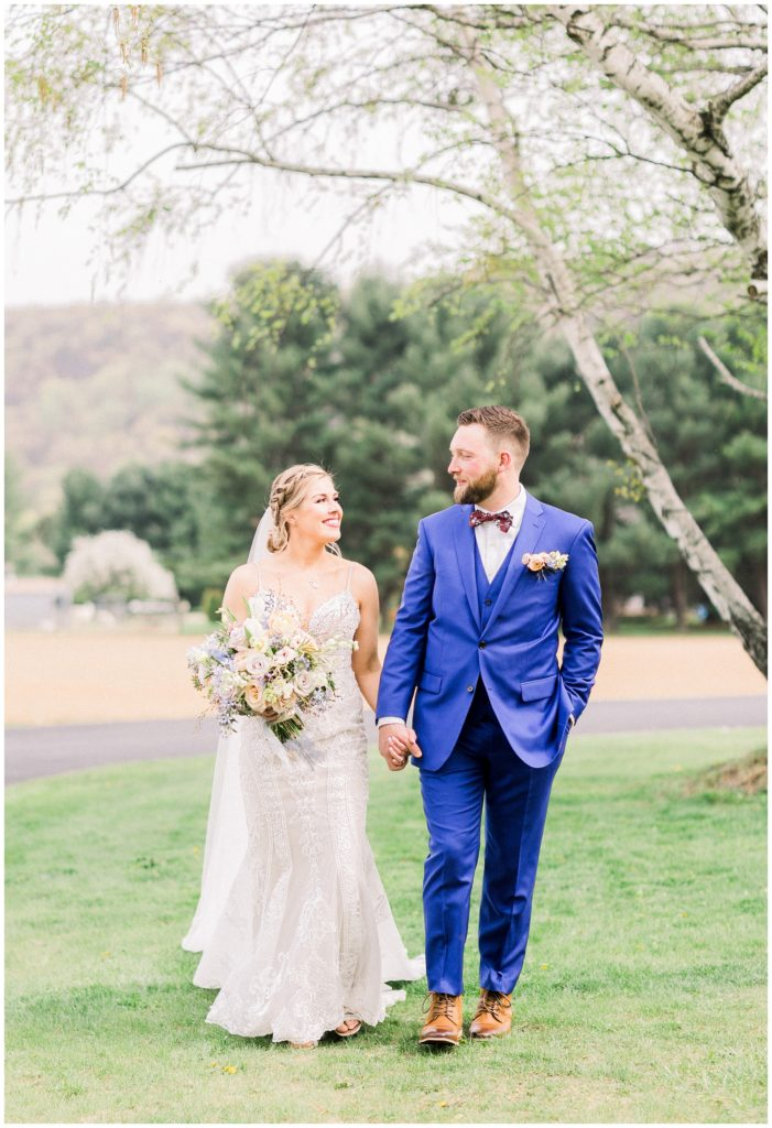 bride and groom walking at Spring wedding in Phillipsburg, New Jersey