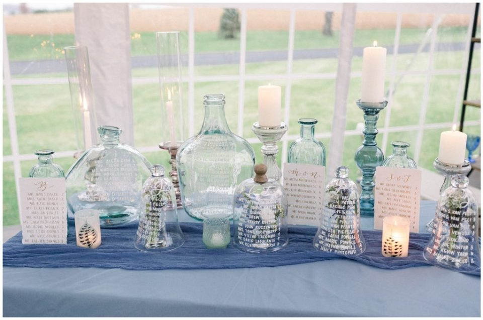 dusty blue calligraphy glass seating chart at Phillipsburg, New Jersey wedding
