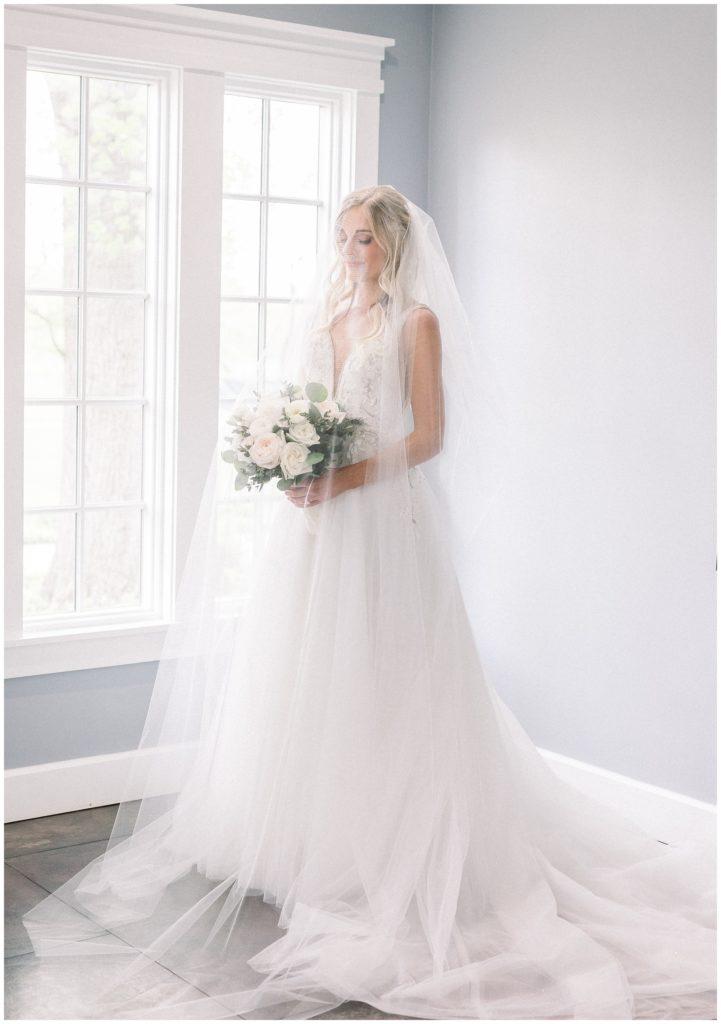bride wearing Hayley Paige wedding dress at Ryland Inn wedding