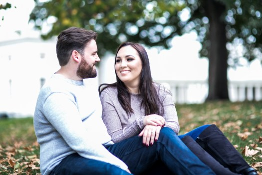 A brunette couple on their engagement shoot in Greenwich Park London