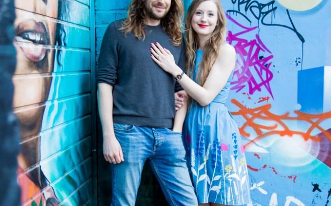 Couple against blue street art