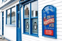 Blue sign for the Old Neptune Pub on Whitstable's West beach