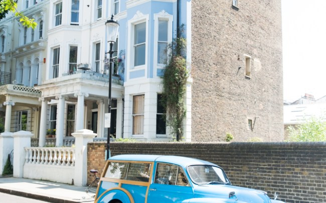 Bright blue classic car Morris Minor in Notting Hill