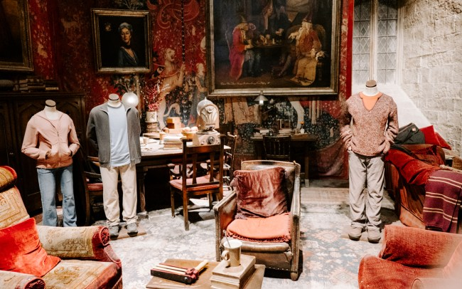 Gryffindor common room set with rustic armchairs and red wallpaper