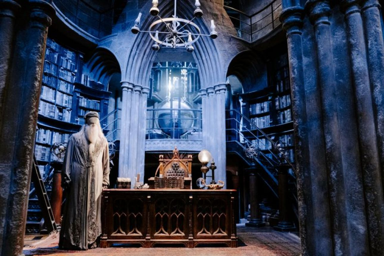 Dumbledore's office set bathed in blue light with model of Dumbledore