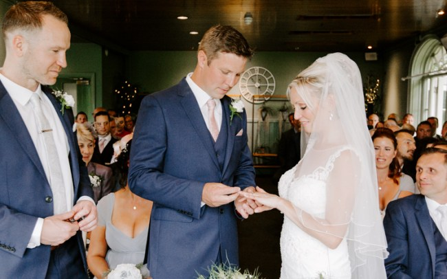 Groom exchanging rings at a New Forest wedding