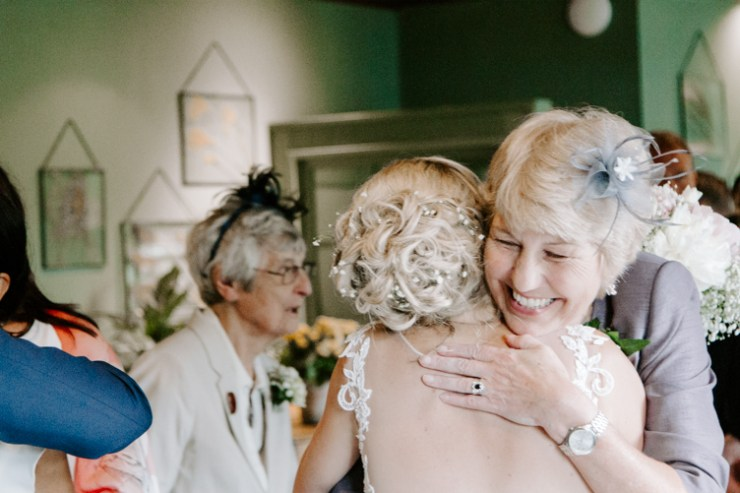 Mother in Law embracing her new daughter in law at her wedding