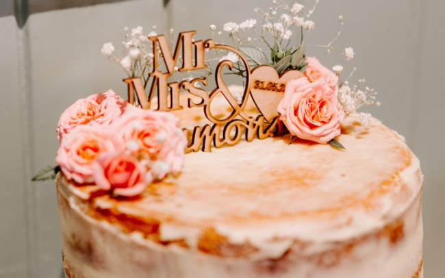 Rustic pink wedding cake with buttercream