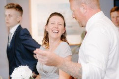 Bridesmaid laughing at her partner