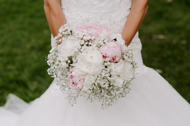 Close up of a bride's white and pink bouquet