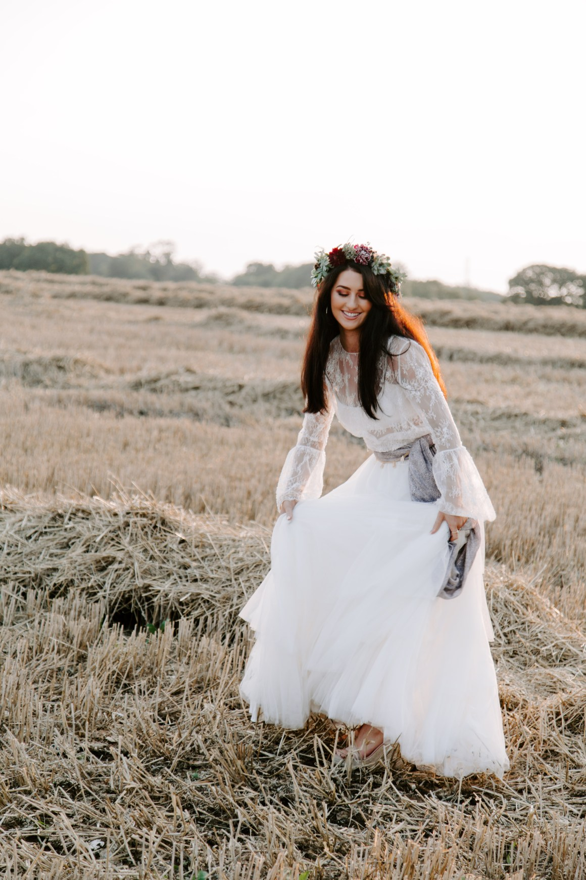 Bohemian bride at sunset wearing floral crown
