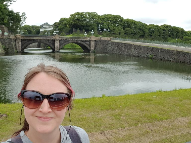 Girl with pink hair taking selfie in Tokyo's imperial palace gardens