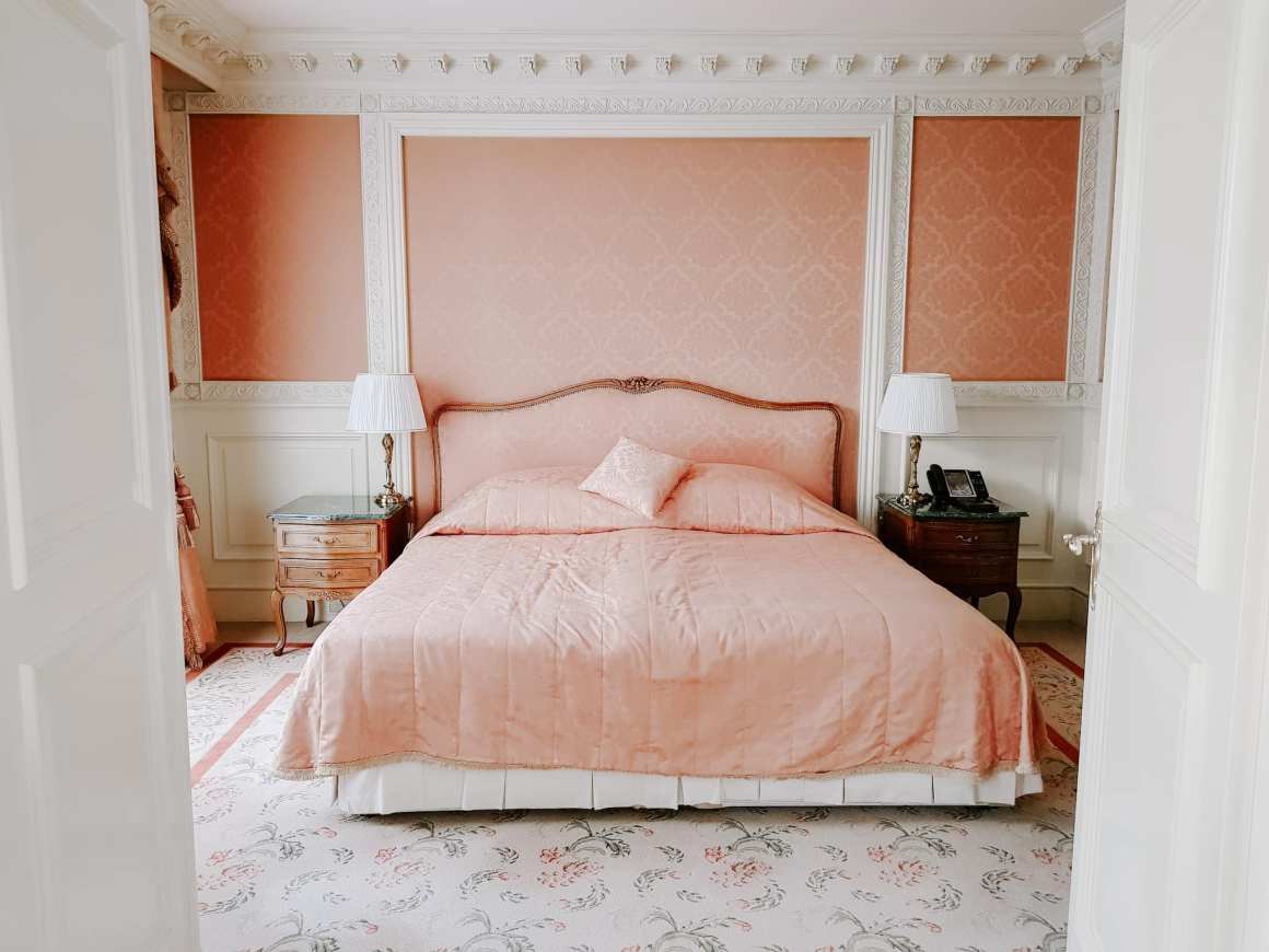 A huge plush pink bed in Vienna hotel