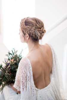 Bride with braided updo and a lace gown