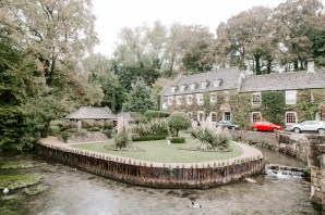 Ivy coloured hotel in the Cotswolds with river in front of it