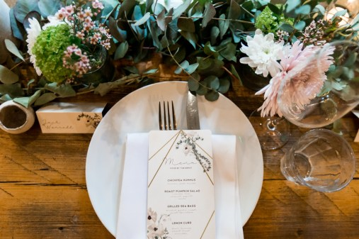 Foliage on a wedding bench with cream stationery