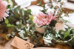 Cute pink and white flowers at a wedding reception table