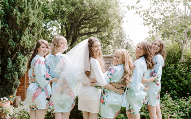 Bridal party in matching dressing gowns