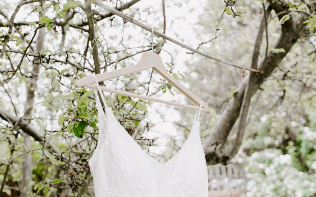 Bohemian wedding dress hanging from tree