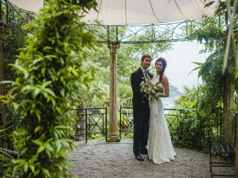 Newly married couple under an outdoor canopy