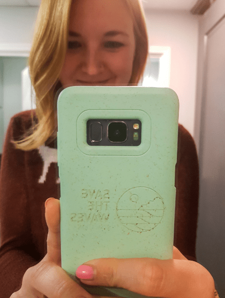 Blonde girl taking selfie with Pela phone case