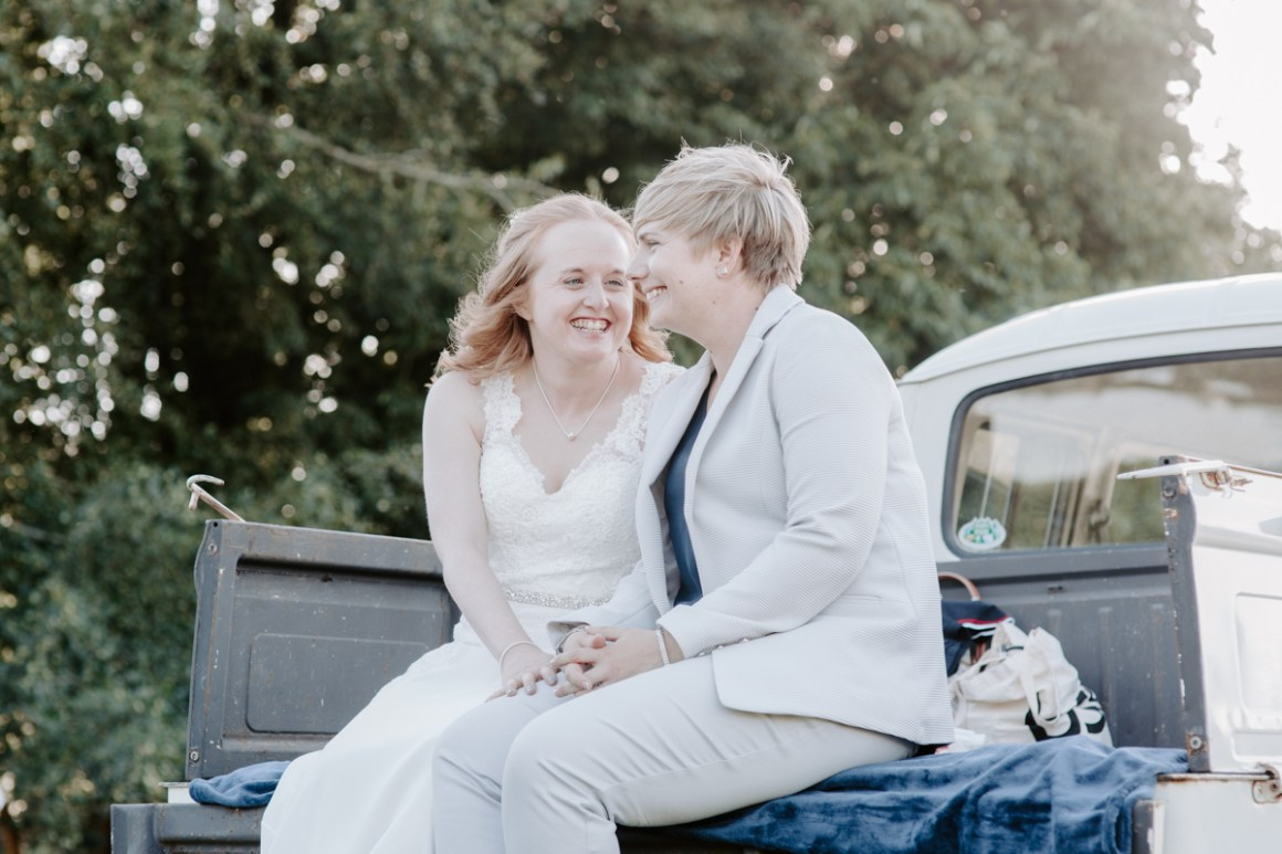 Brides laughing on a VW Vintage