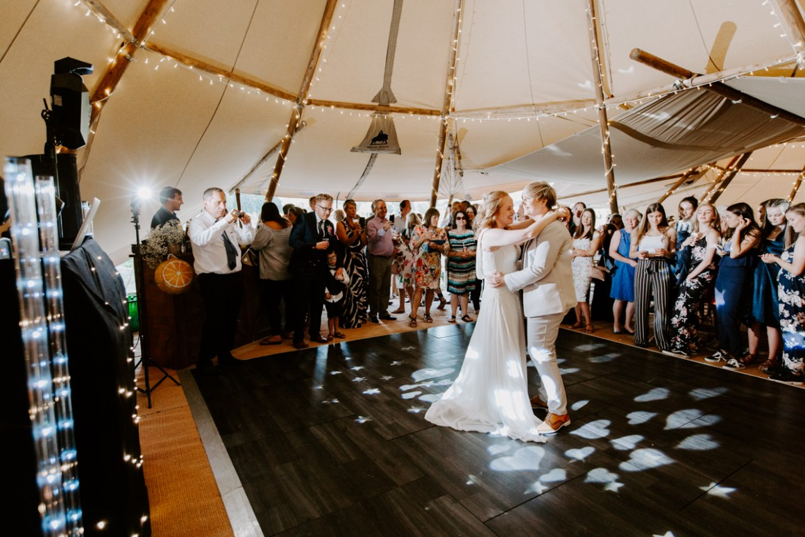 Newly married couple dancing in tipi