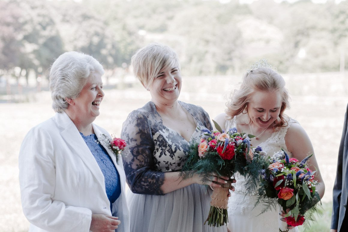 Brides laughing with Mother of Bride at wedding day