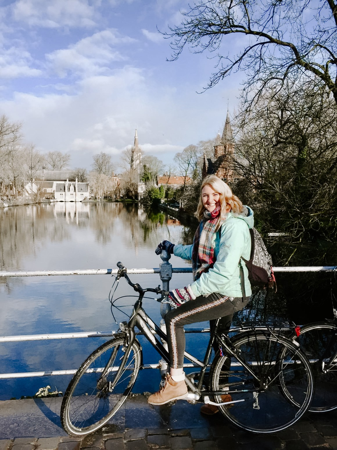Cycling around Minnewaterpark in Bruges
