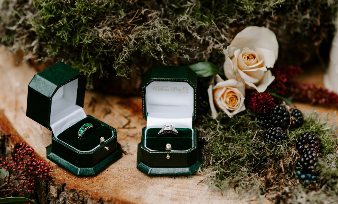 Vintage inspired wedding rings on a rustic table
