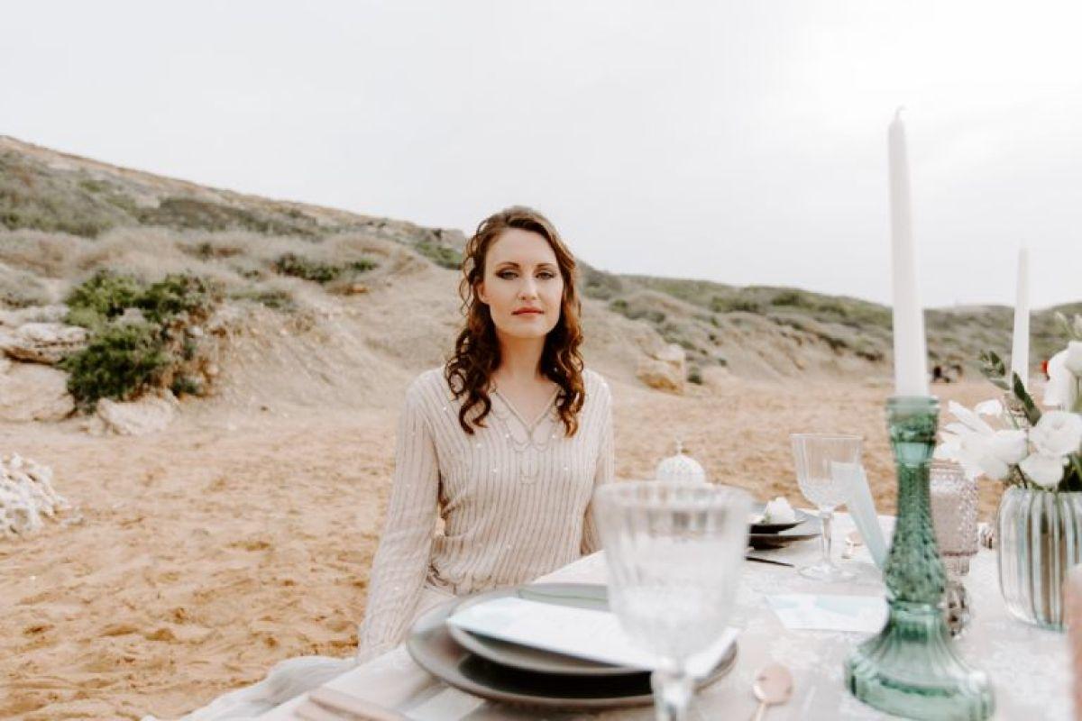 A bride sat at a beach