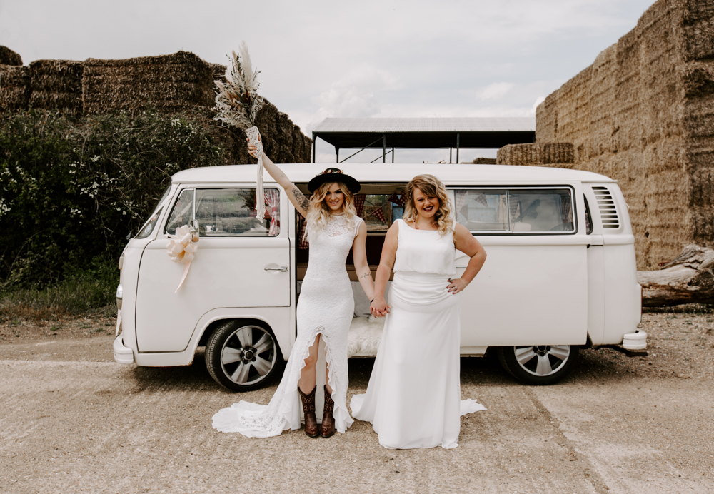 Brides stood in from of VW Campervan