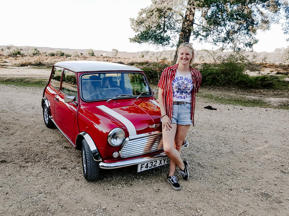 Woman with her restored Classic Mini