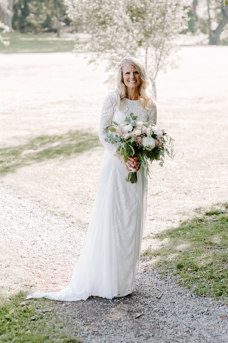 Bride wearing a Grace Loves Lace 2019 wedding dress